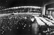 The mass funeral for 27 victims of the OLA fire, held at the Illinois National Guard Armory on Friday, December 5, 1958. An overflow crowd of parents, neighbors, friends and the curious public attended the emotional service.