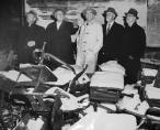 Members of the Coroner's Blue Ribbon Jury visit the site during their investigation of the school fire in the days following the disaster. Fresh snow has fallen into room 211 through a hole in the roof chopped by firemen attempting to vent heat and smoke from the school during the height of the fire.