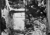 This is where the fire started. At left is the bottom of the northeast stairwell where, to the right out of view, a 30 gallon fiber drum containing waste paper was the presumed starting point.