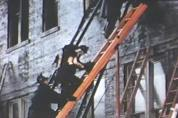 Firemen retrieve the body of a young girl from room 212. But it is too late - everyone remaining in the room now is dead. Firemen rescued at least 160 students from the burning school before conditions in the classrooms became unsurvivable.