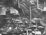 At around 3:00 p.m., a large portion of the roof over the north wing collapsed, crashing down on the students remaining in the north wing classrooms. The shock wave and blast of superheated smoke and gases that surged through the second floor effectively ensured that no student or teacher remaining would be leave the fire-ravaged north wing alive. Here in room 209, only one student remained and perished when the roof caved it, thanks to a porch cover below a corner window, and to the efforts of Father Ognibene and parent Sam Tortorice who helped students escape that same corner window.