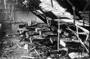 This is room 209 looking west underneath the collapsed roof. The windows are just out of view on the left. Note the teacher's desk at the front of the classroom, with her chair precariously balanced just in front of it on a pile of debris. (Life Magazine Photo)