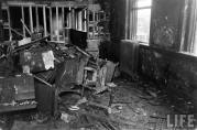 This is room 210, looking at a pile of charred desks that were moved out of the way during the recovery of bodies. The hole that firemen punched in the wall from room 212 next door can be seen just beyond the debris. This was a fourth grade classroom, where the youngest and smallest victims of the fire perished. (Life Magazine Photo)
