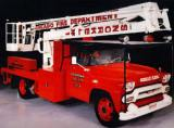"This is the ""Quinn Snorkel"" truck that responded to the OLA fire. Commissioner Robert J. Quinn came up with the idea of mounting a nozzle atop a mobile boom, much like tree-trimmers use, providing great mobility for both firefighting and rescue operations. The photo is from a 1993 calendar issued by Figgie International who owned American LaFrance (fire fighting equipment manufacturer) in 1993. This unit was restored to the 1958 appearance by the Snorkel Company for the American LaFrance Museum collection. (Photo courtesy of Ken Soderbeck of ""Hand in Hand Restoration"")"